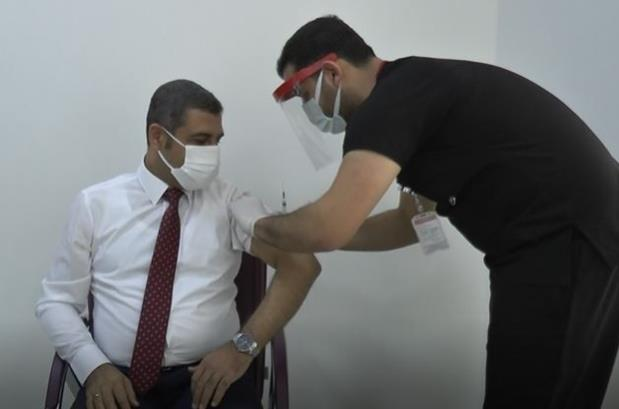 Aşı yaptıran MHP milletvekili Ali Muhittin Taşdoğan koronavirüse yakalandı